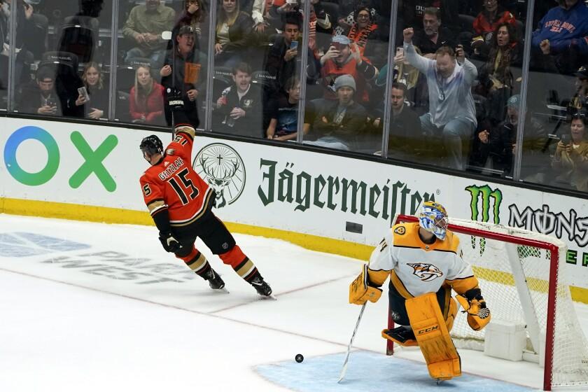 Ducks captain Ryan Getzlaf, left, celebrates after scoring the winning goal past Nashville Predators goaltender Juuse Saros.