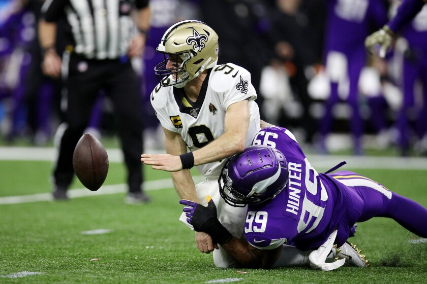 New Orleans Saints quarterback Drew Brees fumbles the ball as he is sacked by Minnesota Vikings defensive end Danielle Hunter in the fourth quarter Sunday.