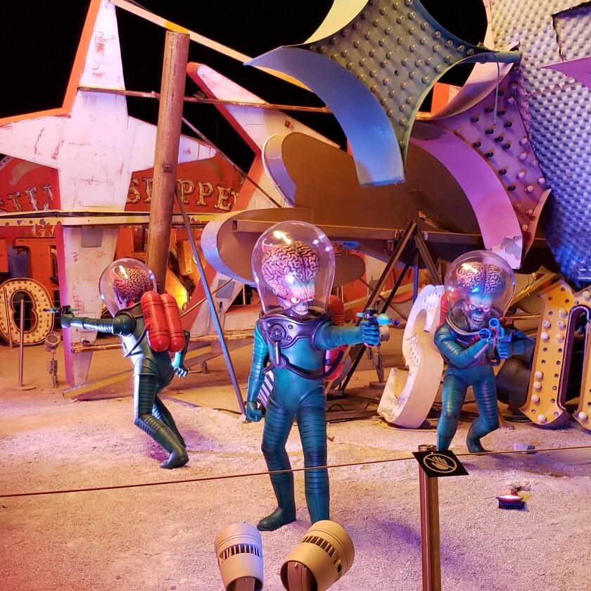 "Aliens appear in defensive mode in ""Lost Vegas"" at the Neon Museum in Las Vegas."