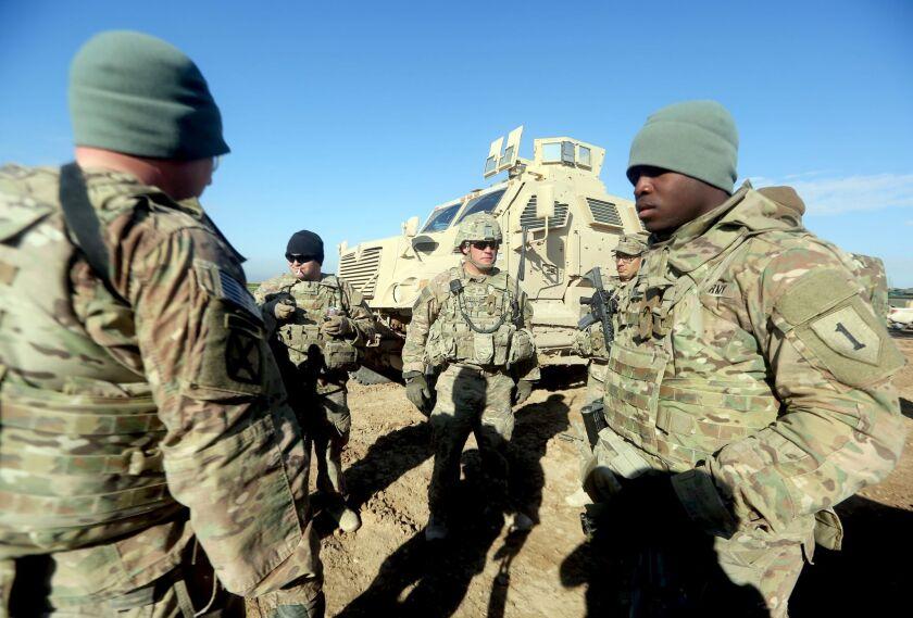 U.S. troops training Iraqi soldiers.