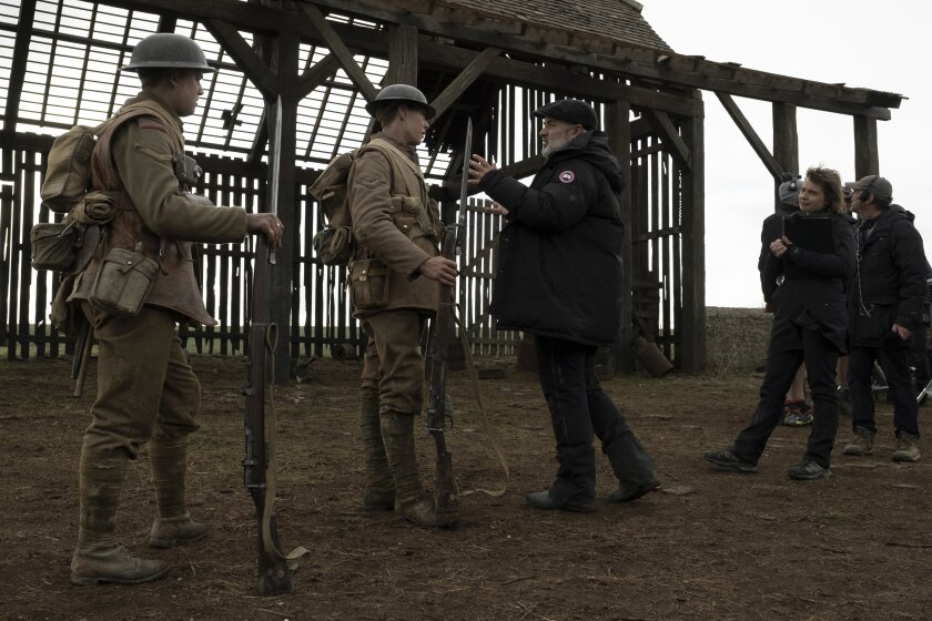 """Dean-Charles Chapman, George MacKay and Sam Mendes on the set of """"1917."""""""