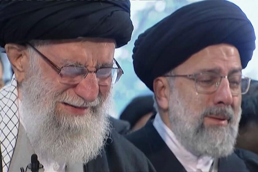 Iranian Supreme Leader Ayatollah Ali Khamenei weeps as he leads a prayer over the coffin of Gen. Qassem Suleimani.