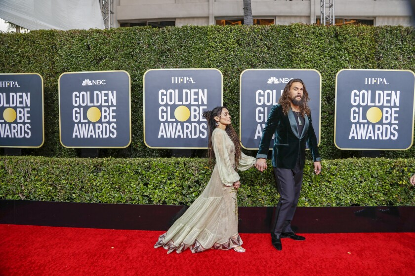 Hit: Jason Momoa in a green velvet Tom Ford suit and black Valentino trousers.