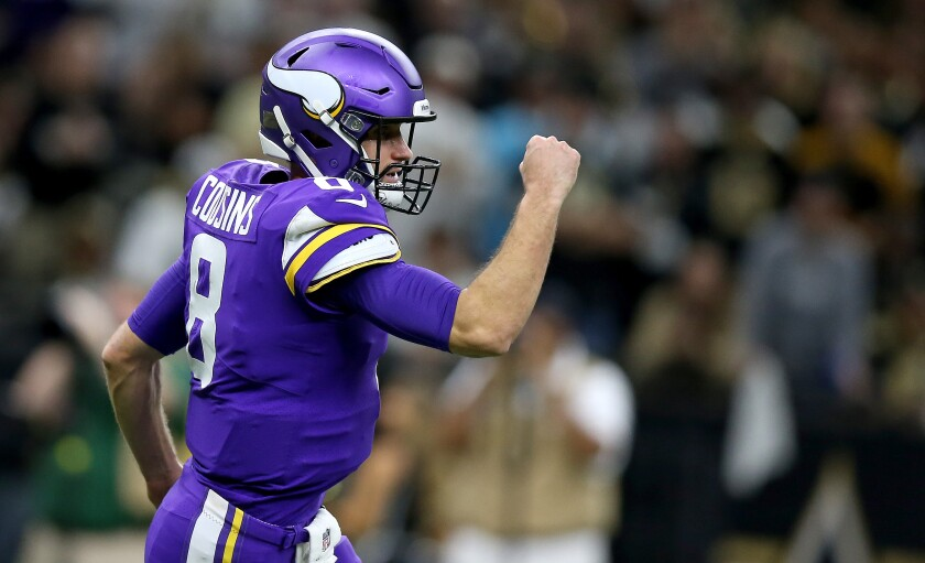 Minnesota Vikings quarterback Kirk Cousins reacts during the first half of a 26-20 overtime victory over the New Orleans Saints.
