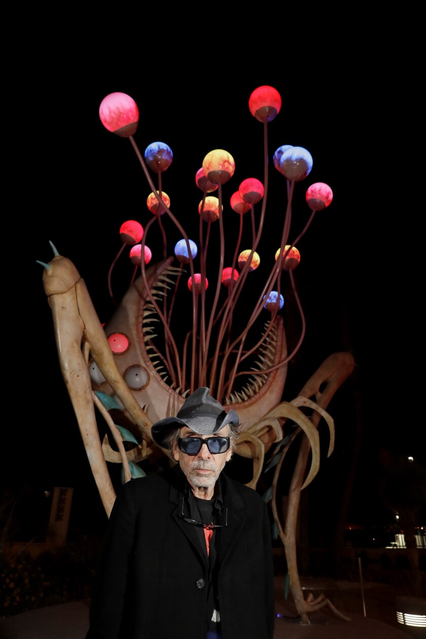 """Tim Burton in front of """"Orb Monster"""" at his """"Lost Vegas"""" exhibit at the Neon Museum."""