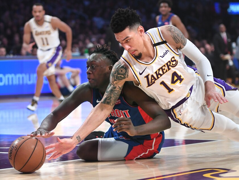 Lakers guard Danny Green and Pistons forward Sekou Doumbouya battle for a loose ball during the second quarter.