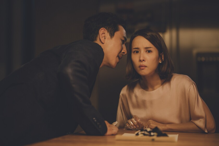 """Lee Sun-kyun and Jo Yeo-jeong in the movie """"Parasite."""""""