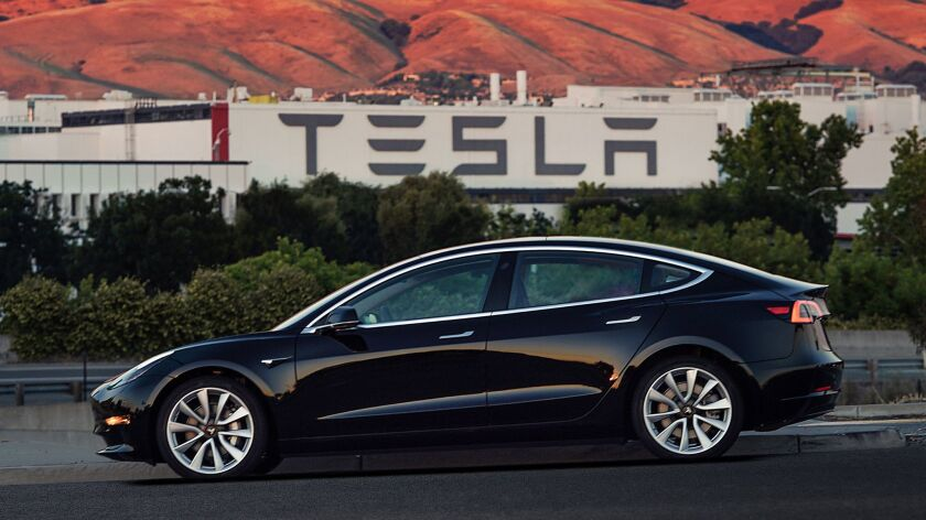 This image provided by Tesla Motors shows the Tesla Model 3 sedan. Electric automaker Tesla has prod