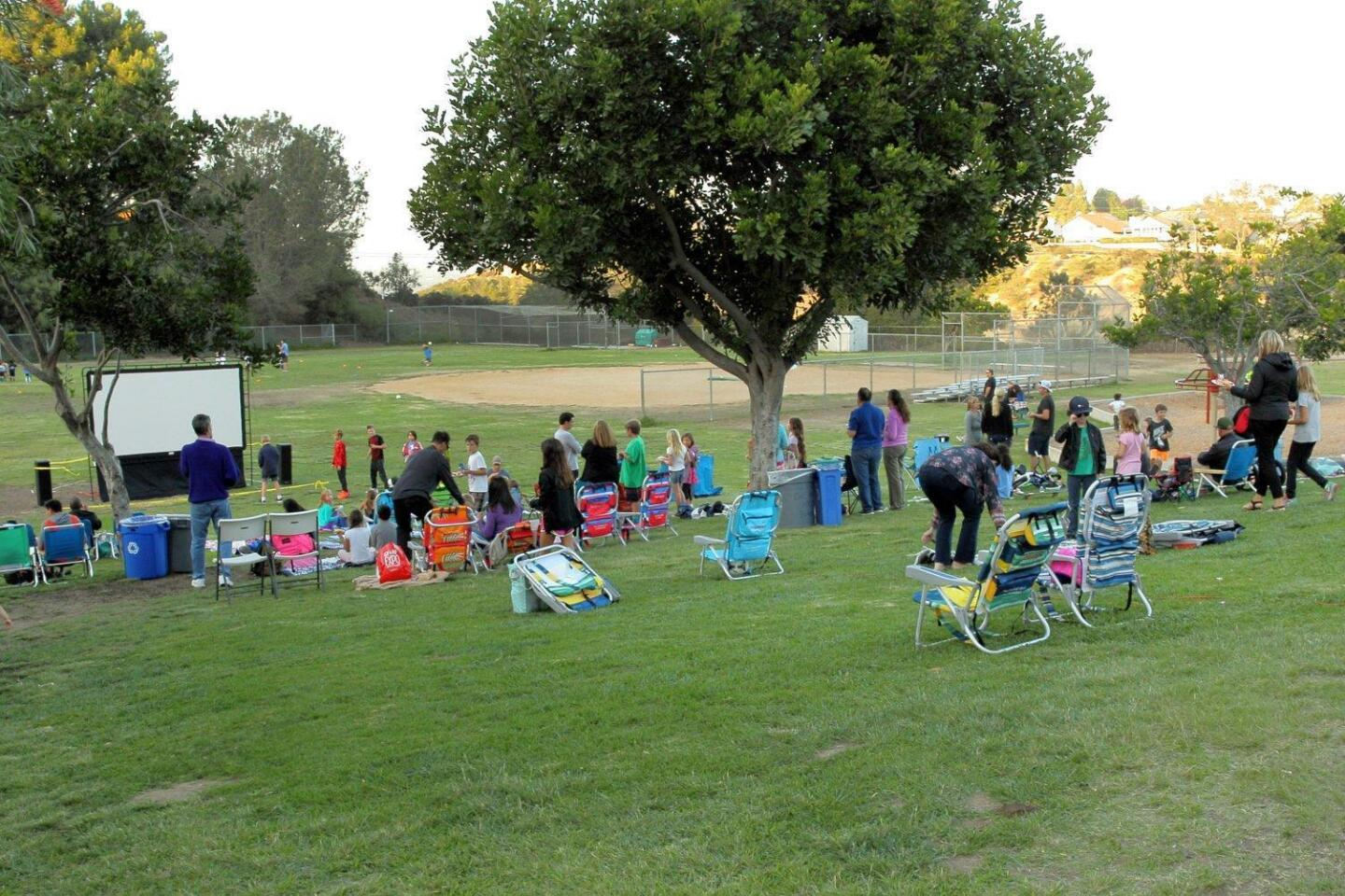 Students and parents gather for Dad's Club Movie Night and BBQ at Del Mar Hills Academy