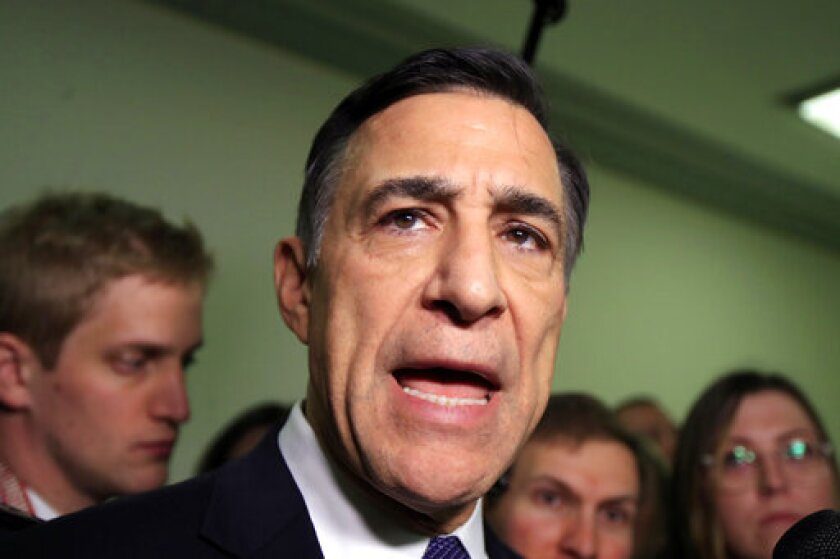 FILE - In this Dec. 7, 2018 file photo Rep. Darrell Issa, R-Calif., speaks to reporters as he leaves a House Judiciary and Oversight Committee closed-door interview on Capitol Hill in Washington. Issa, the former California Rep. plans to run against indicted fellow GOP Congressman Duncan Hunter, The Associated Press has learned.(AP Photo/Manuel Balce Ceneta, File)