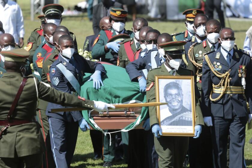 Pallbearers carry the coffin of Kenneth Kaunda , founding President of Zambia , during his State Funeral, in Lusaka, Zambia, Friday, July 2, 2021. Zambia's first president Kenneth Kaunda died at the age of 97 in June. (AP Photo/Tsvangirayi Mukwazhi)