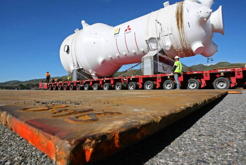 In February 2009, inch-thick steel plates cover soft spots in the 63-year-old highway through San Onofre State Park as one of the new steam generators for the nuclear power plant is transported to its new home.