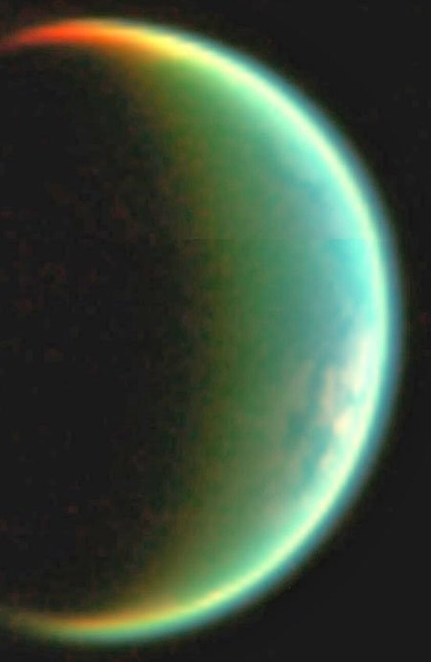 Titan, the only known moon with an atmosphere, may resemble the Earth billions of years ago, before organic compounds formed the basis of life. (NASA)