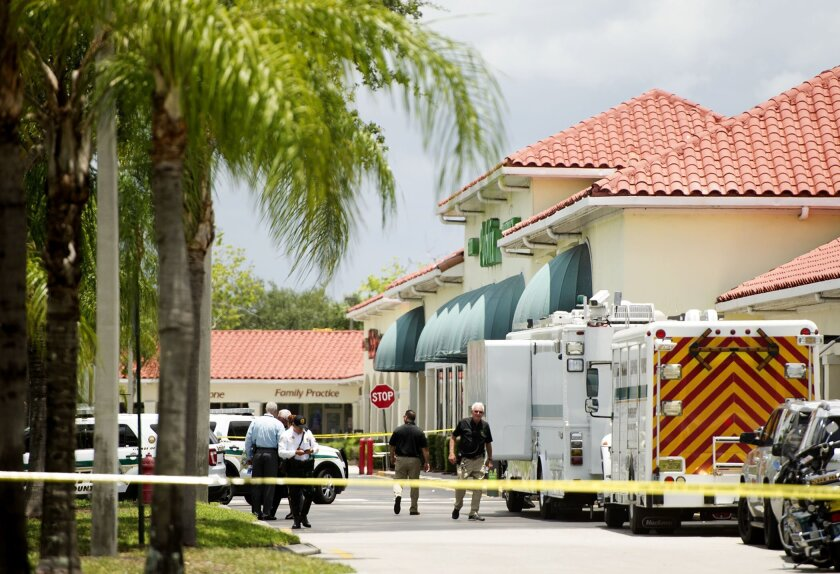 Police gather at the Publix shopping center at the scene of a shooting in Royal Palm Beach, Fla., on Thursday, June 10, 2021. Authorities say a shooting inside a Florida supermarket has left three people dead, including the shooter. (Greg Lovett /The Palm Beach Post via AP)