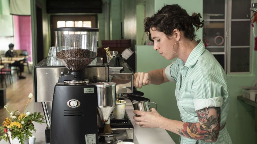 EAST HOLLYWOOD CA AUGUST 31, 2018 -- Cuties Coffee co-owner, Virginia Bauman, makes a latte at LA'