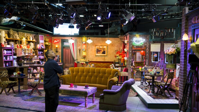 """A worker looks over the """"Central Perk"""" coffee shop set used on the program """"Friends."""" The set is part of Stage 48, a new interactive section of the backlot tour at Warner Bros. Studio in Burbank."""