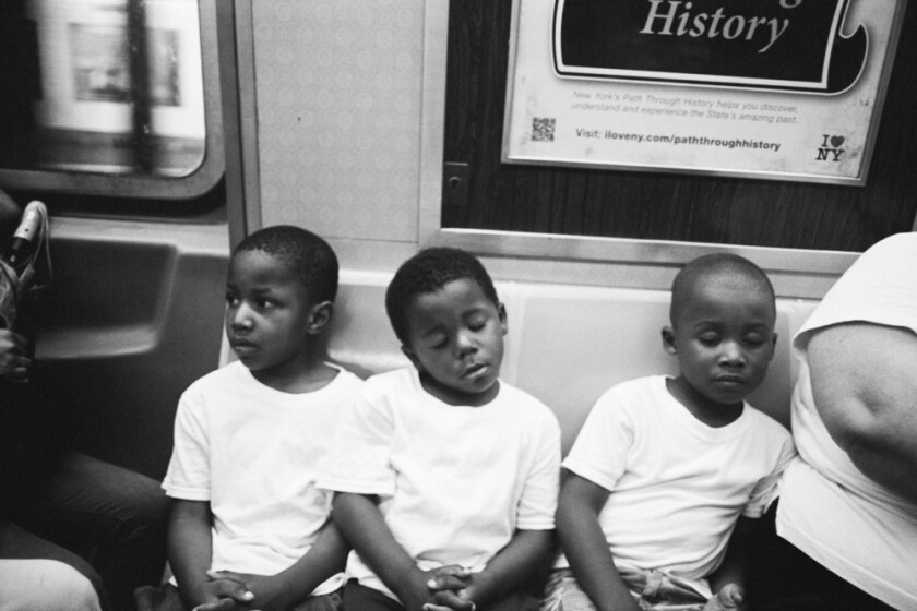 Andre D. Wagner's untitled black and white photograph of three boys on the subway is part of his stirring show at the Papillion in Los Angeles.