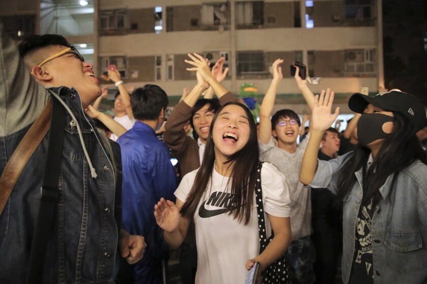 Pro-democracy supporters celebrate in Hong Kong