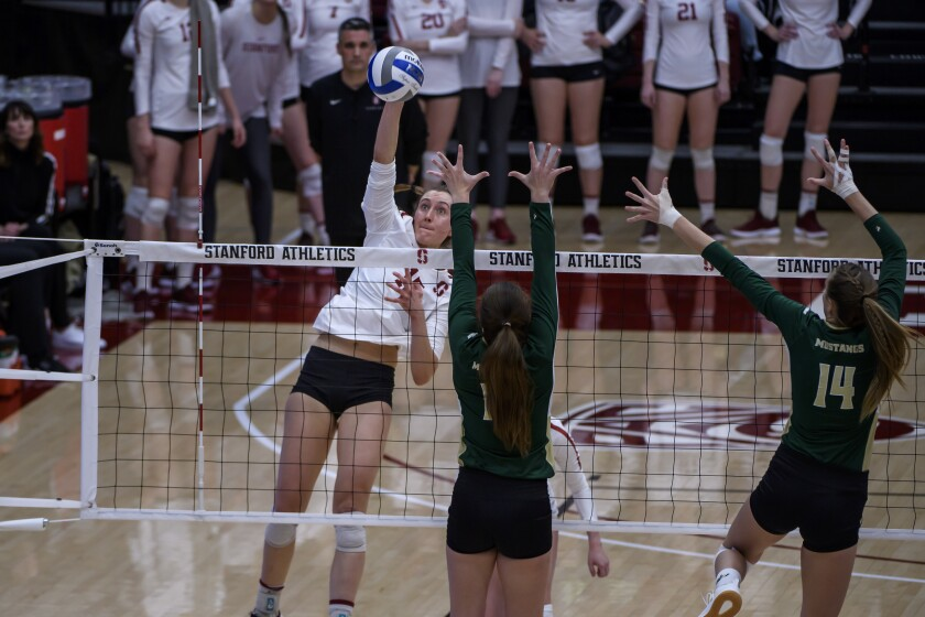 Stanford's Madeleine Gates (far left) had 10 kills in the Cardinal's sweep of Wisconsin in the NCAA final.