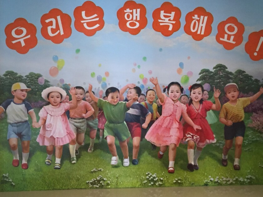 """A mural in the entry hall to the Changchon nursery school says """"we are happ"""