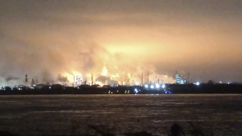 This photo provided by Caleb Christopher Leblanc shows a fire inside a refinery early Wednesday, Feb. 12, 2020, in Baton Rouge, La. The fire erupted at the ExxonMobil refinery late Tuesday, Baton Rouge Fire Department spokesman Curt Monte told news outlets. No injuries were reported and the fire was contained to the location where it started, Monte said. (Caleb Christopher Leblanc via AP)