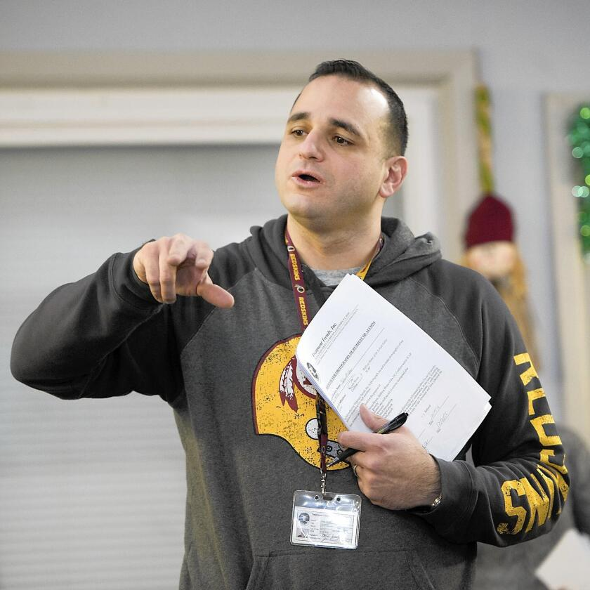 Keenan House counselor Chris Jacob, speaks to recovering addicts during an alumni meeting in December. Jacob says 85 to 95 percent of addicts suffer at least one relapse.