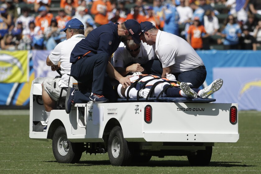 Broncos cornerback De'Vante Bausby is taken off the field after suffering an injury against the Chargers on Oct. 6, 2019.