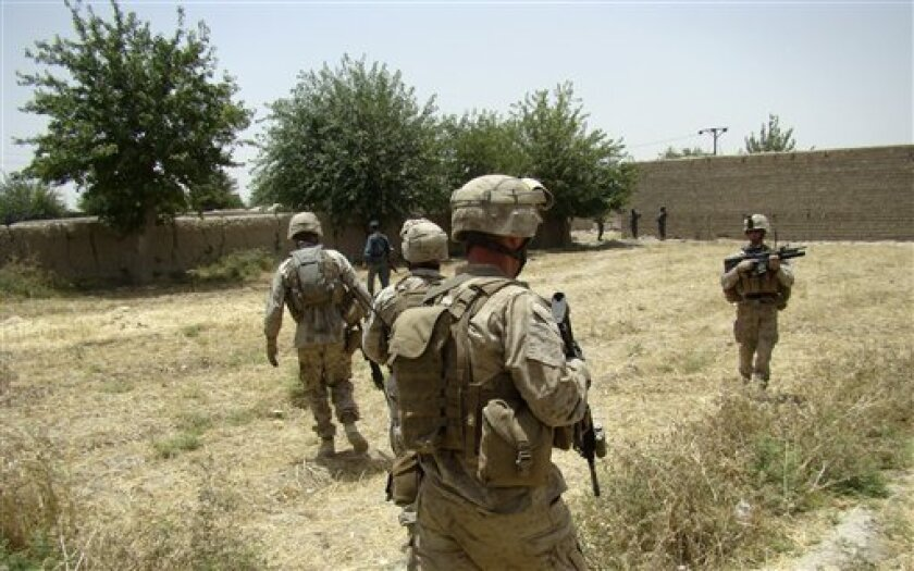 U.S. marines provide security during a government function to lay the foundations for a government administrative department building at Musa Qala in Helmand, Afghanistan, Tuesday, June 8, 2010. (AP Photo/Abdul Khaliq Kandahari)