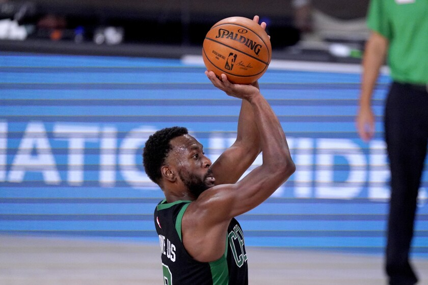 Boston Celtics' Kemba Walker shoots against the Toronto Raptors during the second half of an NBA conference semifinal playoff basketball game Friday, Sept. 11, 2020, in Lake Buena Vista, Fla. (AP Photo/Mark J. Terrill)