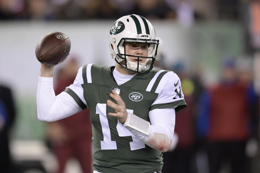 New York Jets quarterback Sam Darnold looks to pass against the Houston Texans during the first half