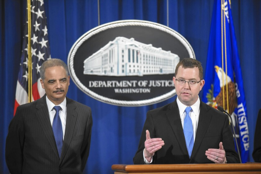 """At a news conference in Washington, Acting Associate Atty. Gen. Stuart F. Delery, right, said of the Standard & Poor's settlement: """"We brought this case because S&P committed fraud."""" Atty. Gen. Eric H. Holder Jr. is at left."""