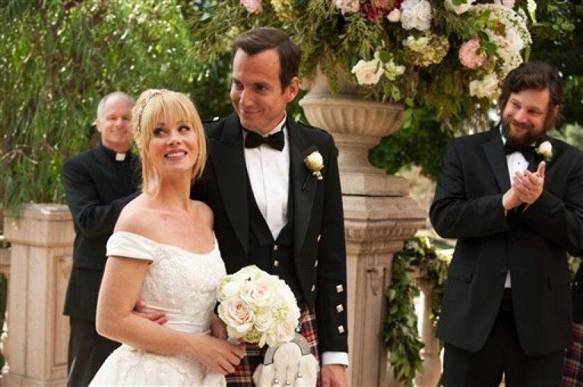 "This undated publicity photo released by NBC shows Christina Applegate, left, as Reagan Brinkley and Will Arnett, as Chris Brinkley, in the TV series, ""Up All Night,"" Season 2, ""The Wedding,"" Episode 211.  Applegate says she's bowing out of NBC's ""Up All Night."" In a statement Friday, the actress s"