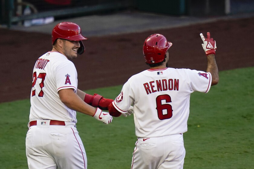 Anthony Rendon, right, celebrates with teammate Mike Trout after hitting a two-run home run.