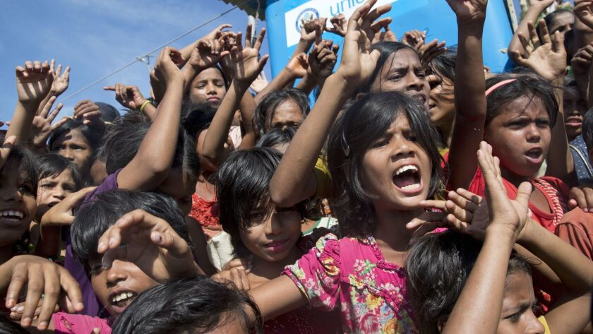 Rohingya refugee children shout slogans during a protest against the repatriation process at Unchipr