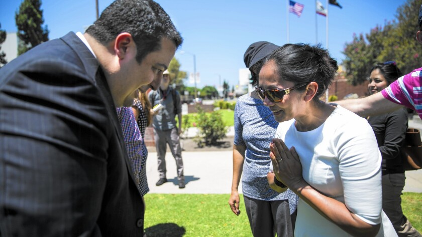 El Monte mayor Andre Quintero and Rotchana Sussman bow to each other after the kickoff of events commemorating the 20th anniversary of the rescue of Thai workers imprisoned as slaves.