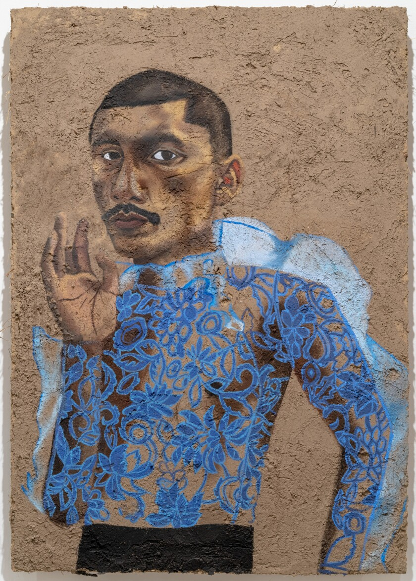 A portrait of performance artist Sebastian Hernandez painted on adobe by Rafa Esparza