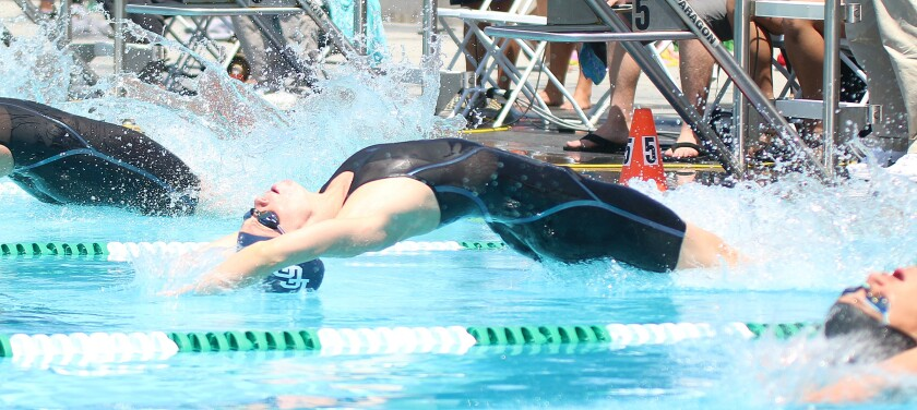 Harvey fires out of the blocks in the 2019 CIF 100 backstroke.