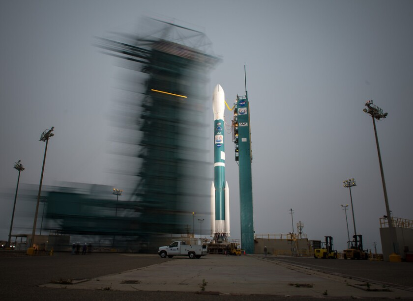 The launch gantry is rolled back to reveal the United Launch Alliance Delta II rocket with the Orbiting Carbon Observatory-2 satellite on board at Vandenberg Air Force Base in California.