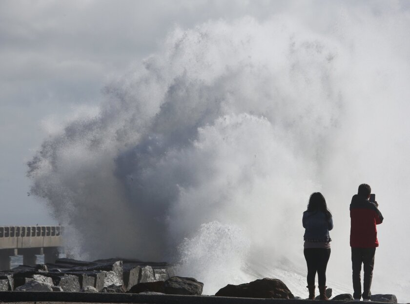 High surf with waves like those that lashed Cabrillo Beach in San Pedro on Jan. 7 will pound Central and Southern California this week, forecasters said.