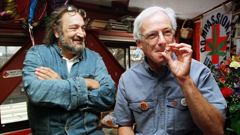 Dennis Peron, right, founder of the Cannabis Buyers Club and longtime activist, smokes marijuana in 1996 next to Jack Herer, of Los Angeles.