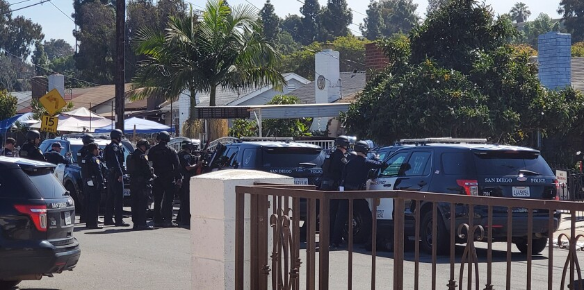 Several police gathered on a Southcrest street where a 10-year-old holed up in a shed and shot at police