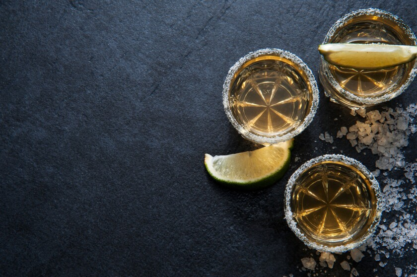 Tequila shots with lime slice, top view