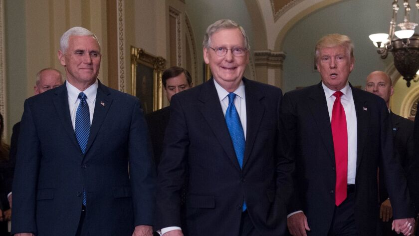 Vice President Mike Pence, Sen. Mitch McConnell and President Trump in the Capitol.
