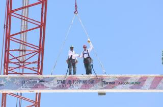 Final steel beam placed in new Rams stadium construction