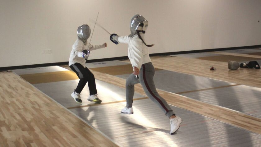 Young fencers run drills at La Jolla Fencing Academy