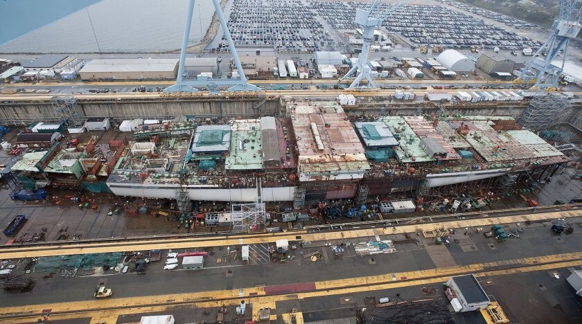 The Navy's next aircraft carrier, the Gerald R Ford, is halfway complete in a Virginia shipyard.