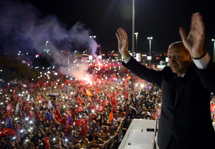 Turkish Prime Minister Recep Tayyip Erdogan greets his supporters following his return to Istanbul from a four-day trip to North Africa.