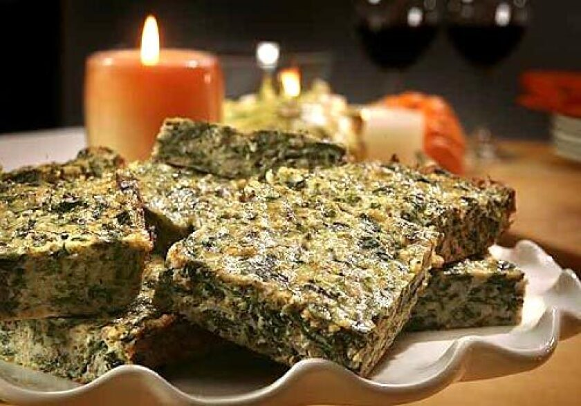 Cut small, these quiche-like collard squares are perfect hors d'oeuvres, but in big squares they are an excellent vegetarian entree.