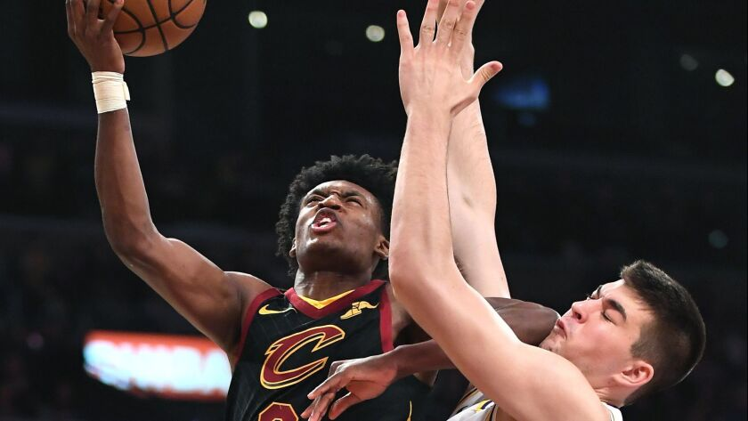 Lakers' Ivica Zubac forces Cleveland Cavaliers Colin Sexton into a missed shot buts gets an elbow to the face in the second quarter at the Staples Center on Sunday.