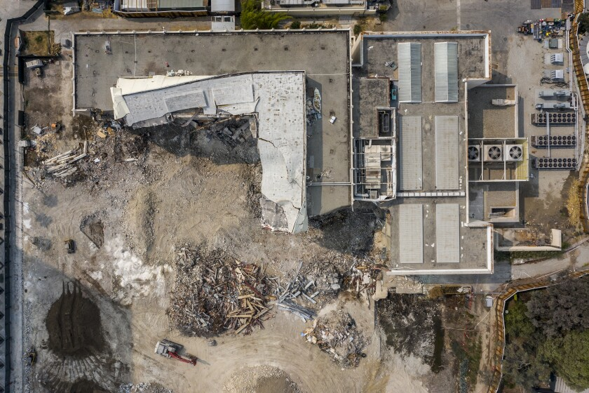 An overhead view of the demolition-in-progress at LACMA shows a buckled fragment of the Ahmanson Building.